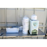 ComfortSpa Model YS-701TM towel warmer with a case of new towel rolls. (2) Schein X-Ray viewers.