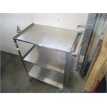 Stainless Steel wheeled medical cart with shelves.