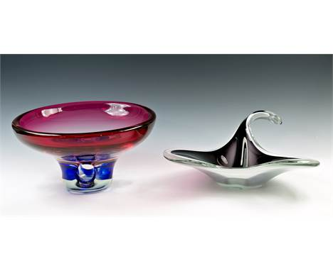 A Flygsfors Coquille cased glass bowl, dated 1960, designed by Paul Kedelv, of stylised ray form, in opaque deep purple and w