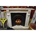 WHITE MARBLE FIREPLACE SURROUND WITH SCROLL DESIGN CORBELS AND FLORAL CENTRAL PLAQUE COMPLETE WITH