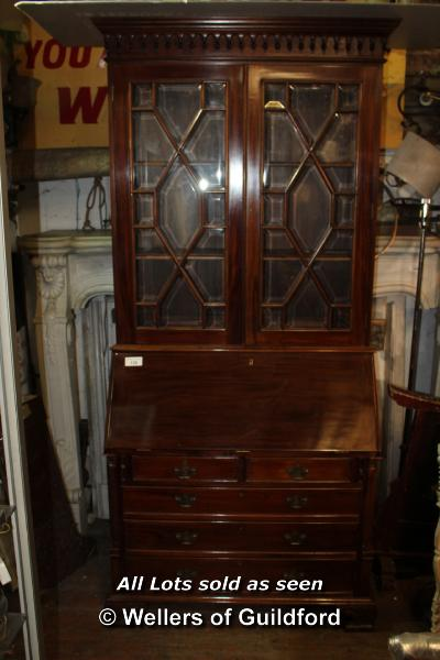 Lot 128 - GEORGIAN STYLE MAHOGANY BUREAU BOOKCASE COMPRISING TWO GLAZED DOORS ABOVE THE PULL DOWN BUREAU FRONT