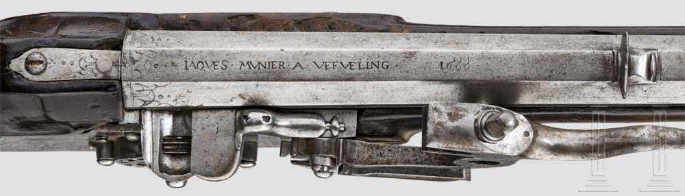 Lot 57 - Über eine Stange im Kolben zu spannende, seltene Radschlossbüchse, Jaques Munier, datiert 1666