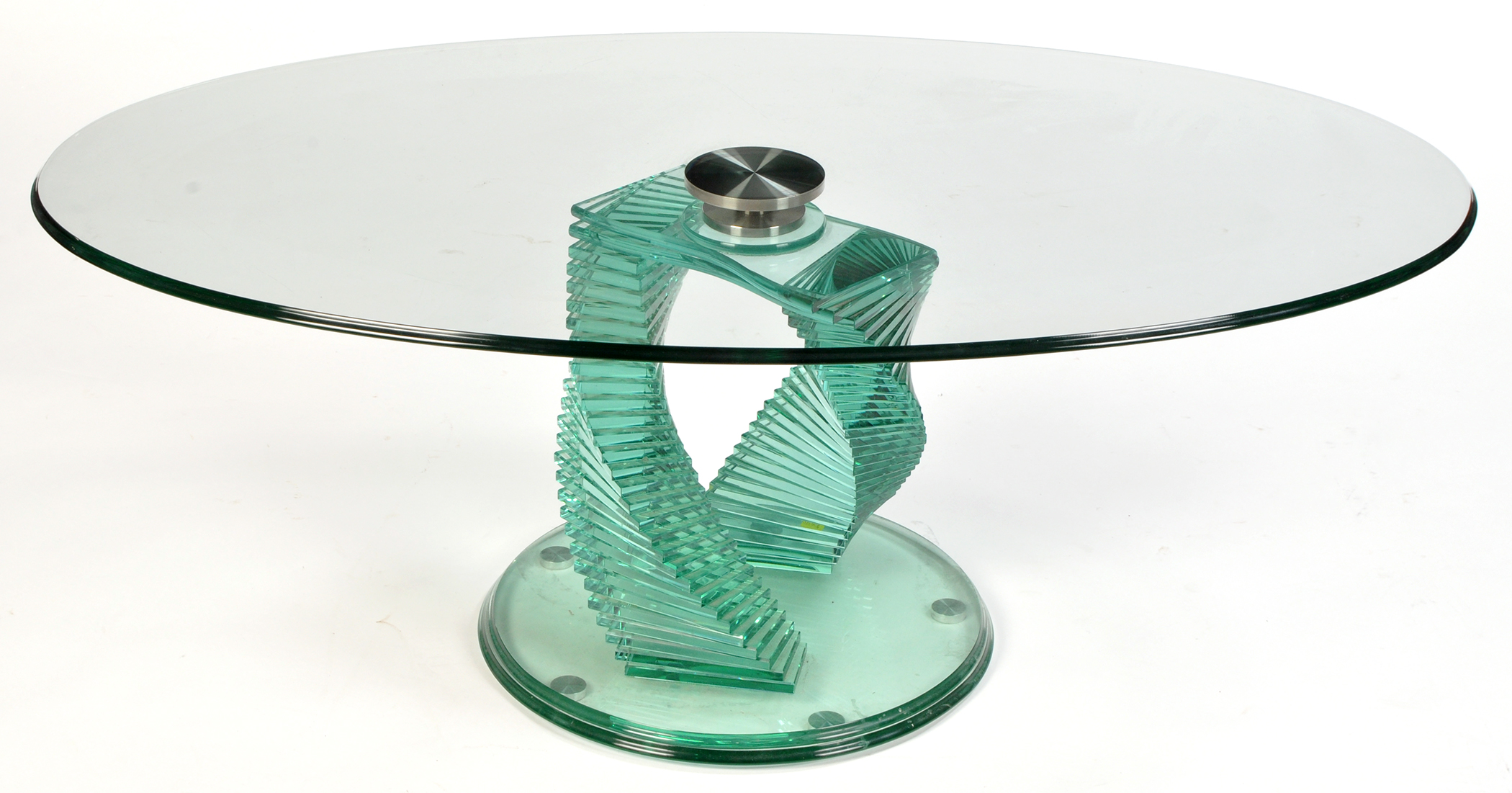 A modern glass coffee table the oval plated glass top raised on