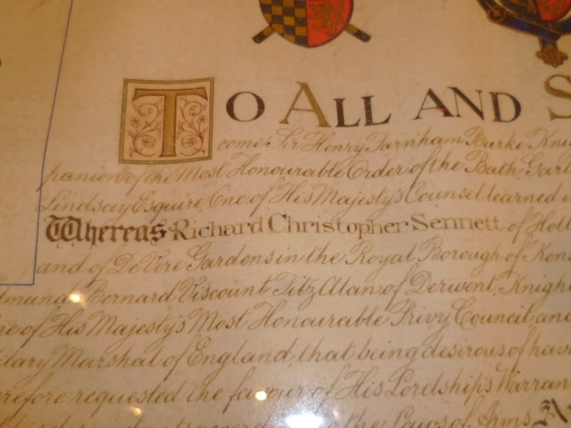 Lot 63 - Illuminated Grant of Arms document with wax seals, awarded to Richard Christopher Sennett, the