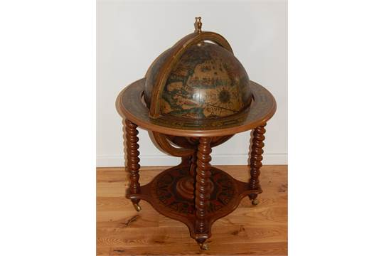 A globe drinks cabinet the hinged top enclosing a bottle interior on spiral  turned legs. - A Globe Drinks Cabinet The Hinged Top Enclosing A Bottle Interior On