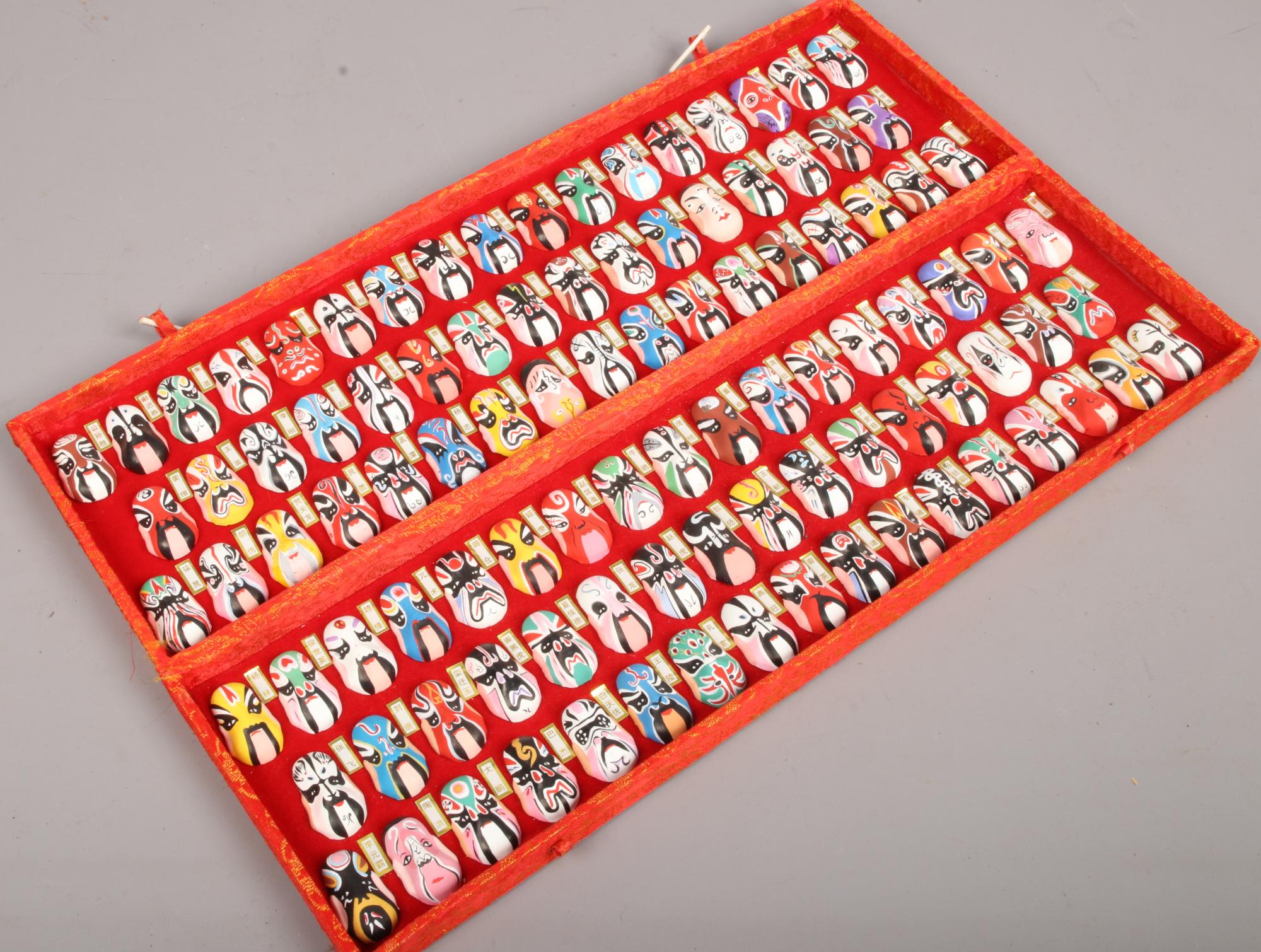 Lot 28 - A cased set of Chinese miniature opera masks.