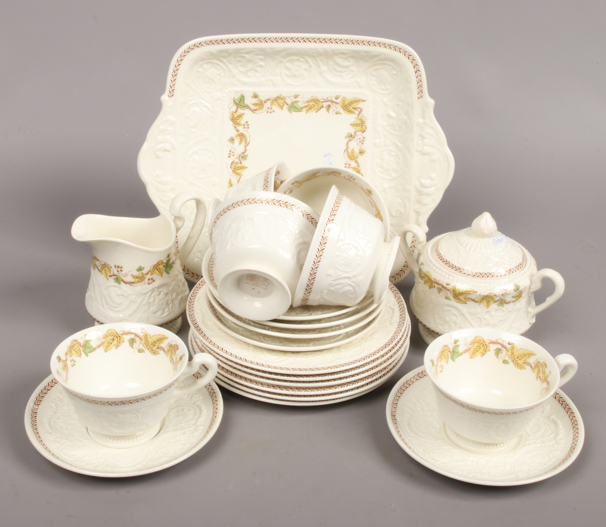 Lot 14 - A Wedgwood Patrician six place teaset decorated in the Golden Ivy pattern.