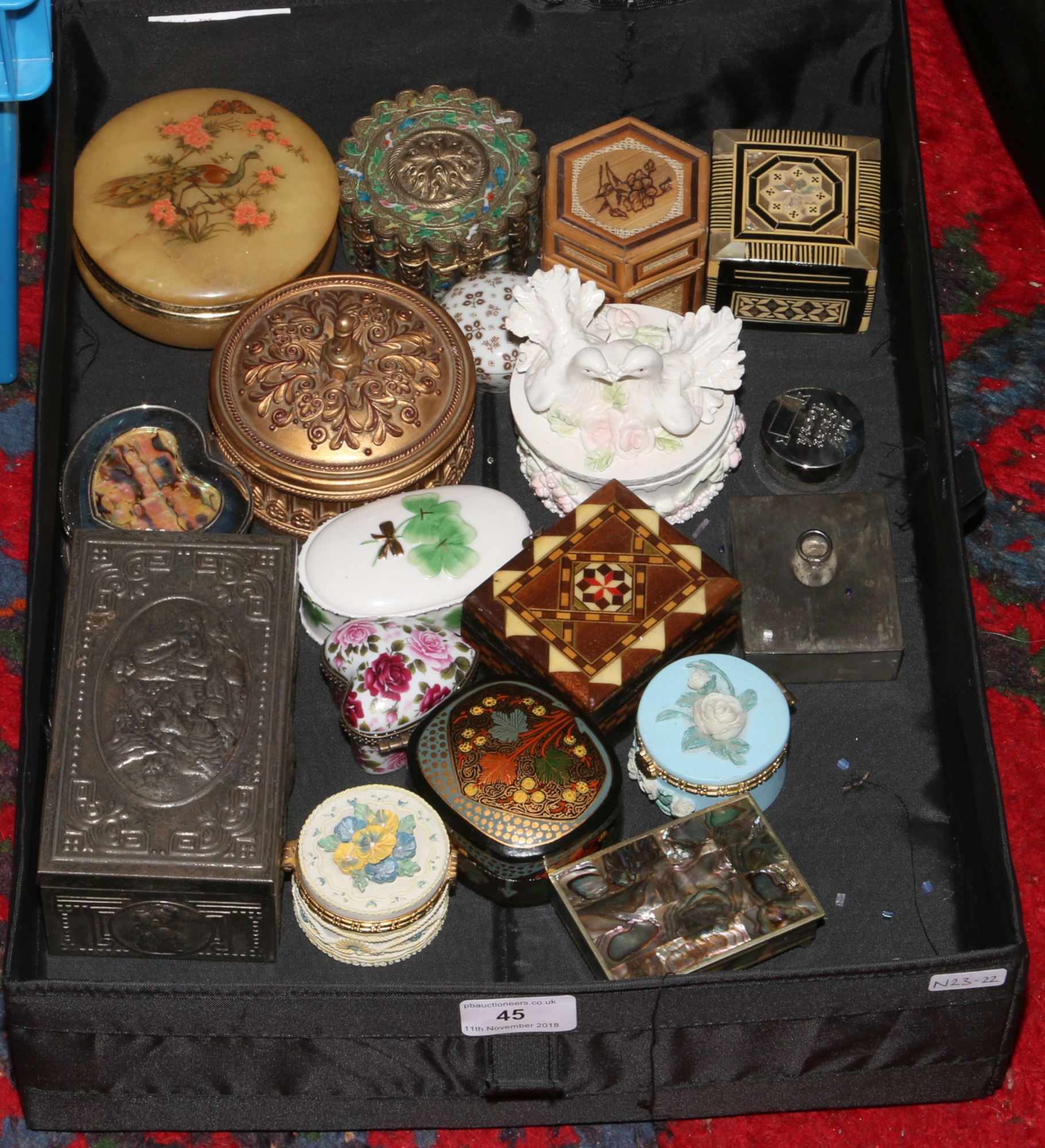 Lot 45 - A box of trinket boxes to include ceramic, wooden, metal examples.