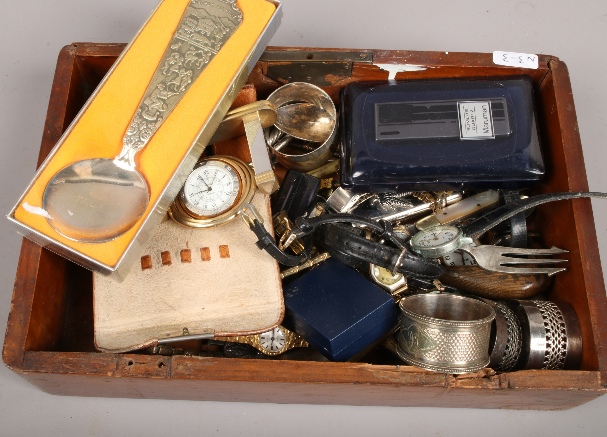 Lot 50 - A box of collectables to include railway buttons, wristwatches, napkin rings, badges etc.