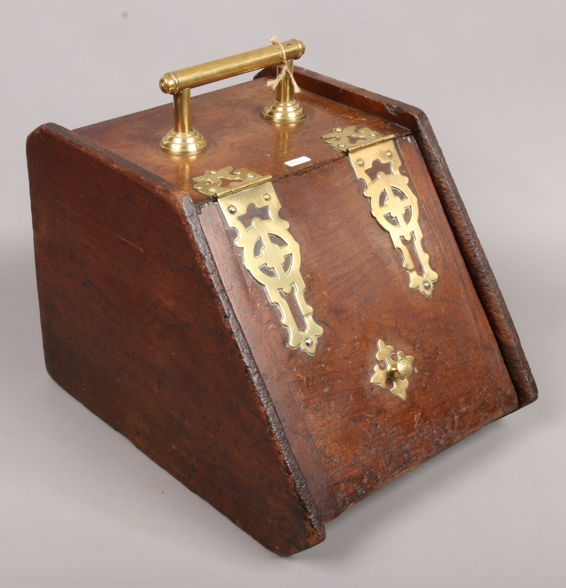 Lot 13 - A brass bound coal scuttle with liner.