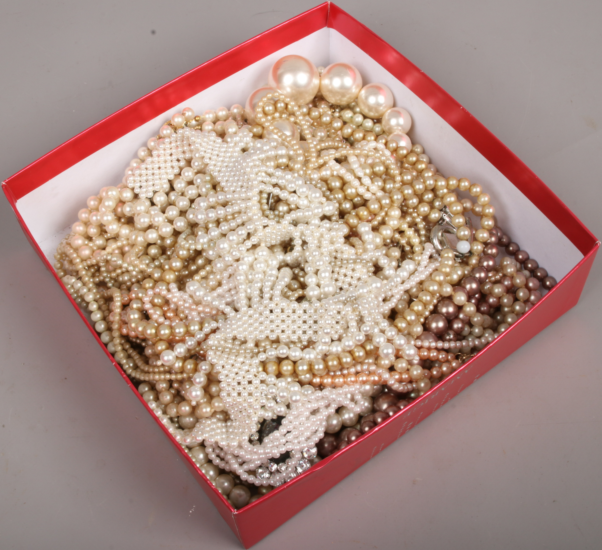 Lot 22 - A box of simulated and freshwater pearls.