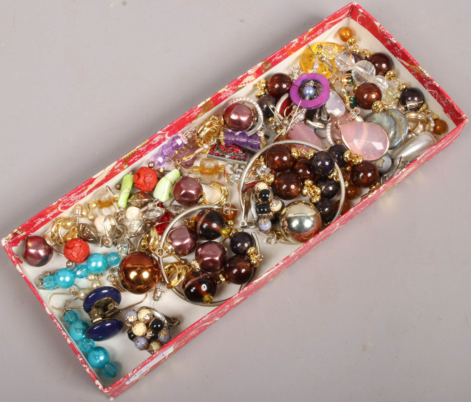 Lot 18 - A tray of costume jewellery earrings including coloured glass and clip on examples.