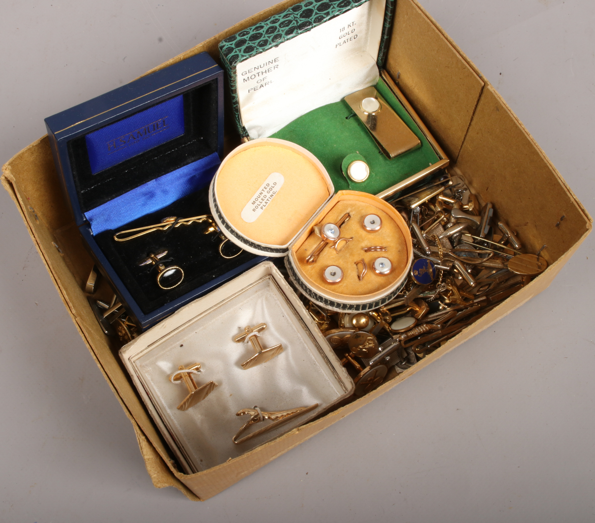 Lot 35 - A box of cufflinks and tiepins to include cased H. Samuel, mother of pearl examples etc.