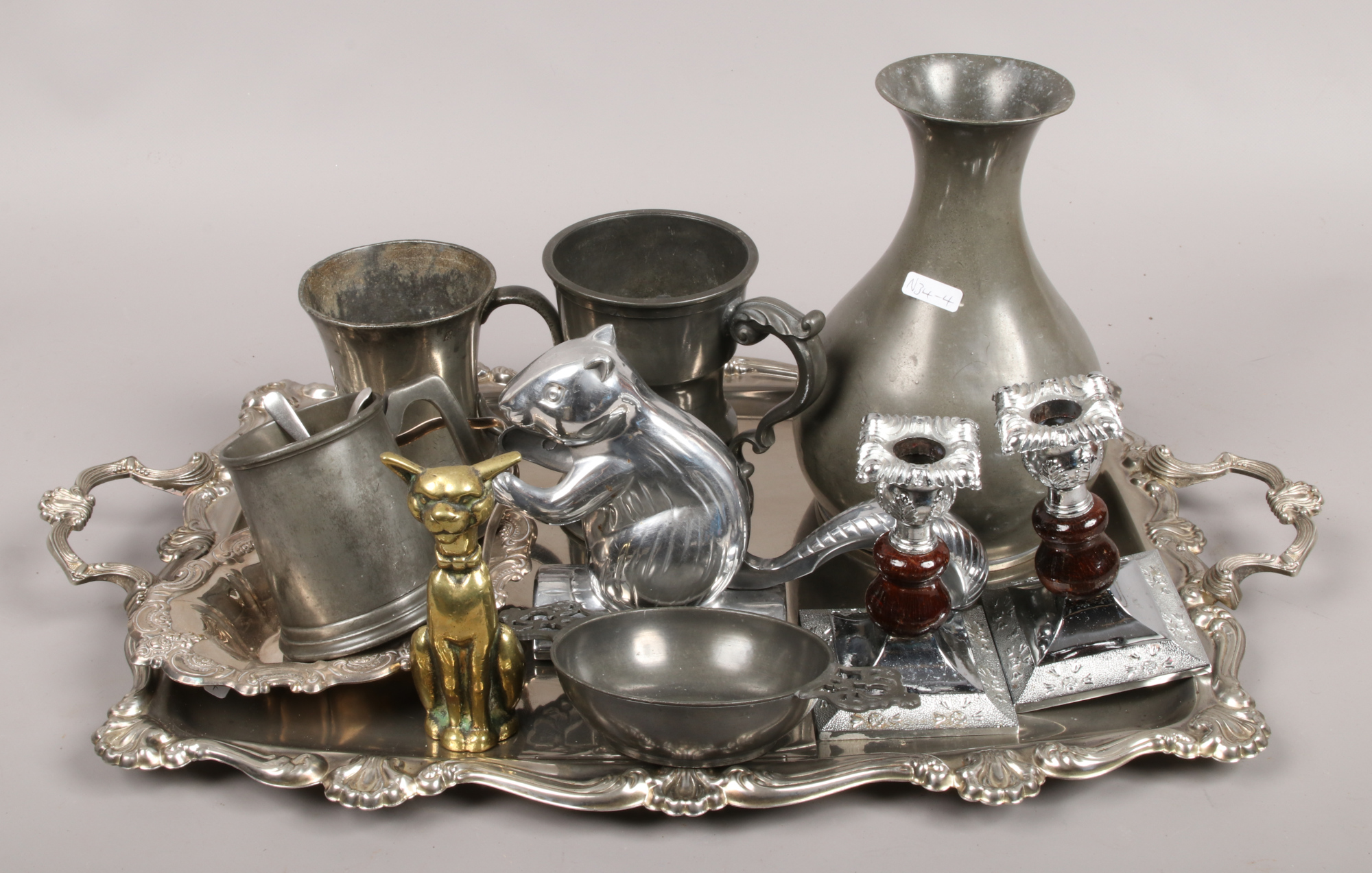 Lot 48 - A quantity of silver plate and pewter including tankards, candlesticks and a serving tray etc.