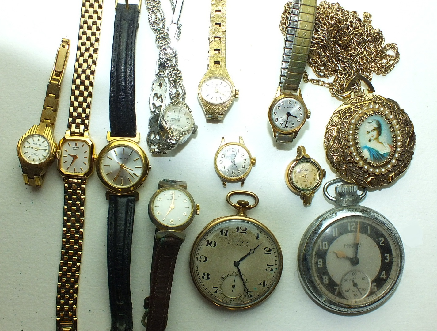 Lot 236 - A Marvin Siciliano gold-plated keyless pocket watch and other watches.