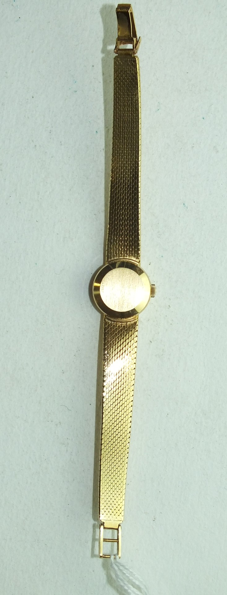 Lot 265 - Omega, a ladies Omega Ladymatic 18ct gold wrist watch, the round dial with claw-set accents, on