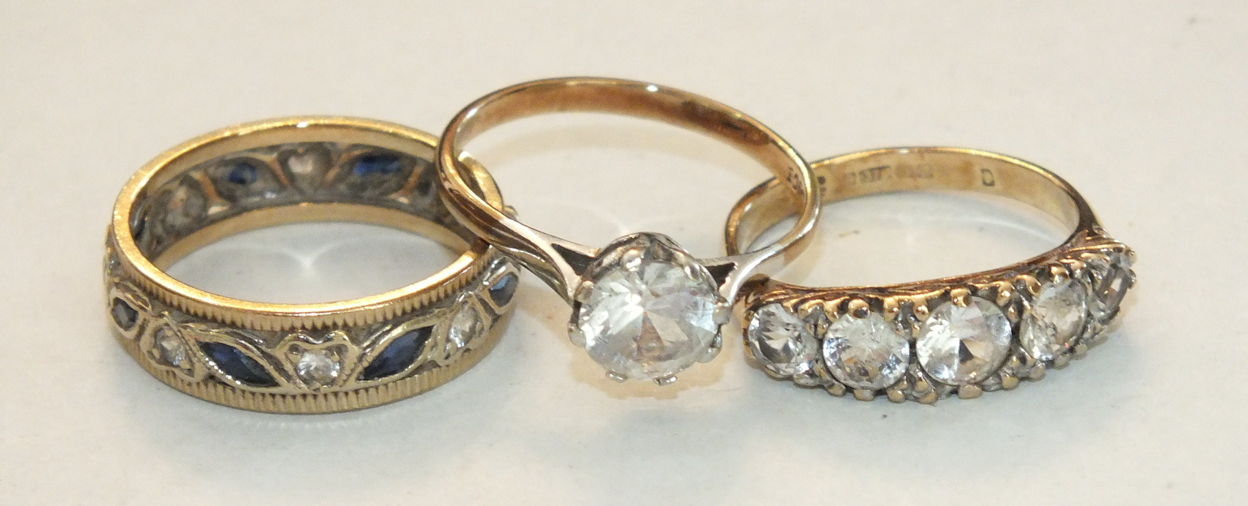 Three 9ct gold rings set synthetic stones, sizes N-O, 8.6g, (3).