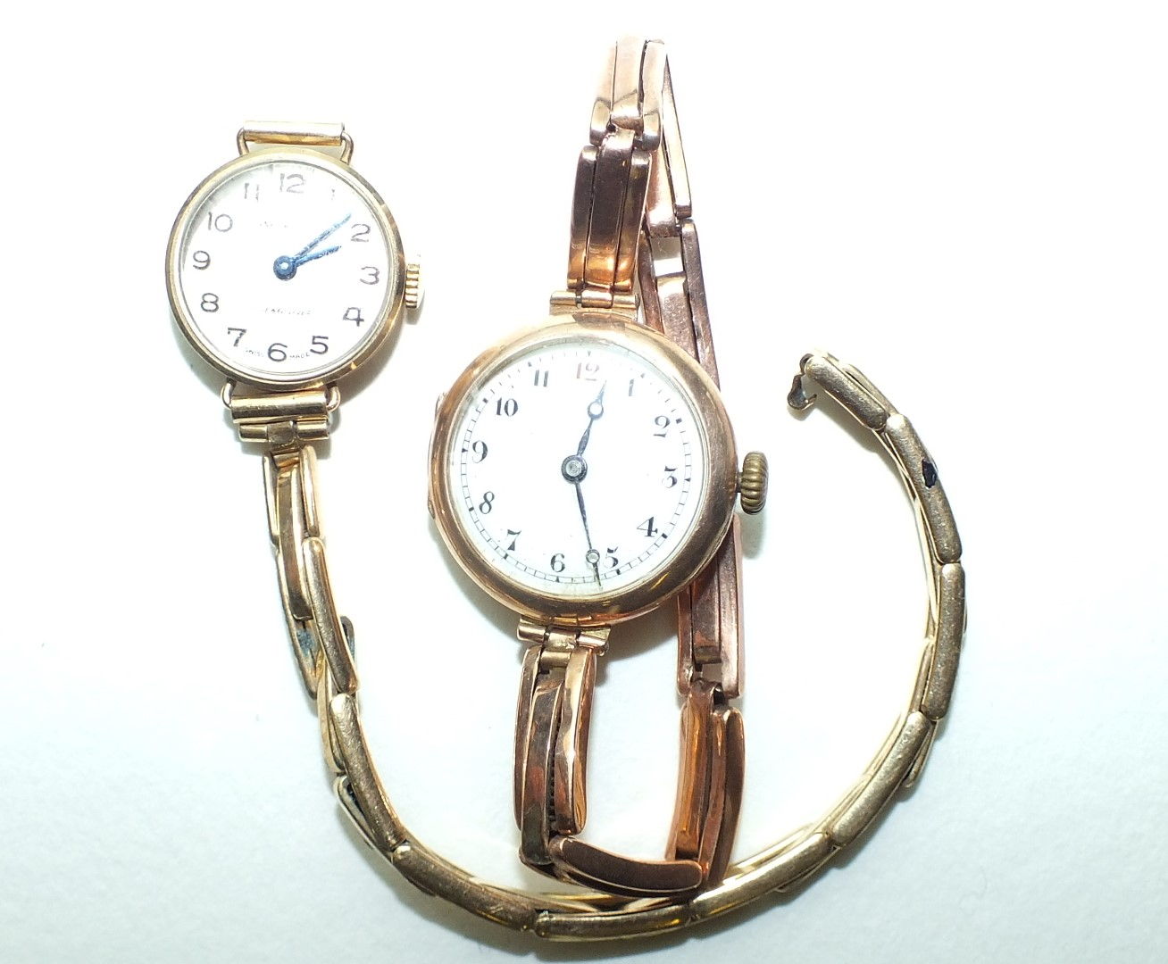Lot 267 - Two ladies wrist watches with 9ct gold cases and sprung bracelets, (both a/f), 31.9g, (2).
