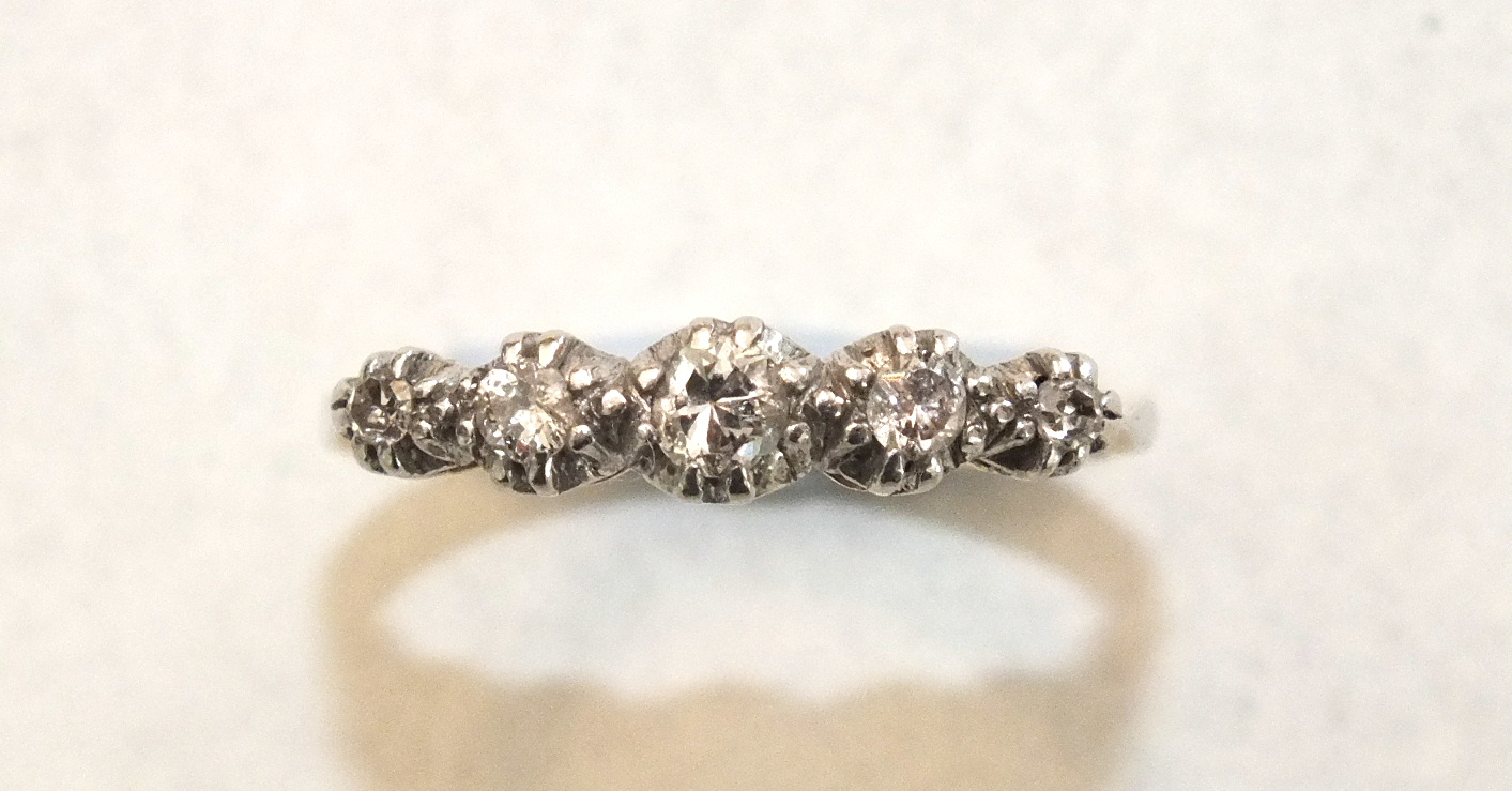 A five-stone diamond ring claw-set graduated brilliant and 8/8-cut diamonds in 18ct yellow gold