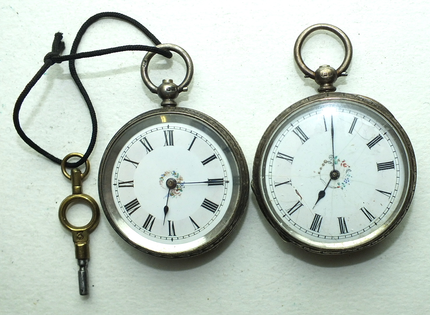Lot 247 - Two Late-Victorian silver-cased open-face keyless pocket watches, (one with dial a/f), (2).