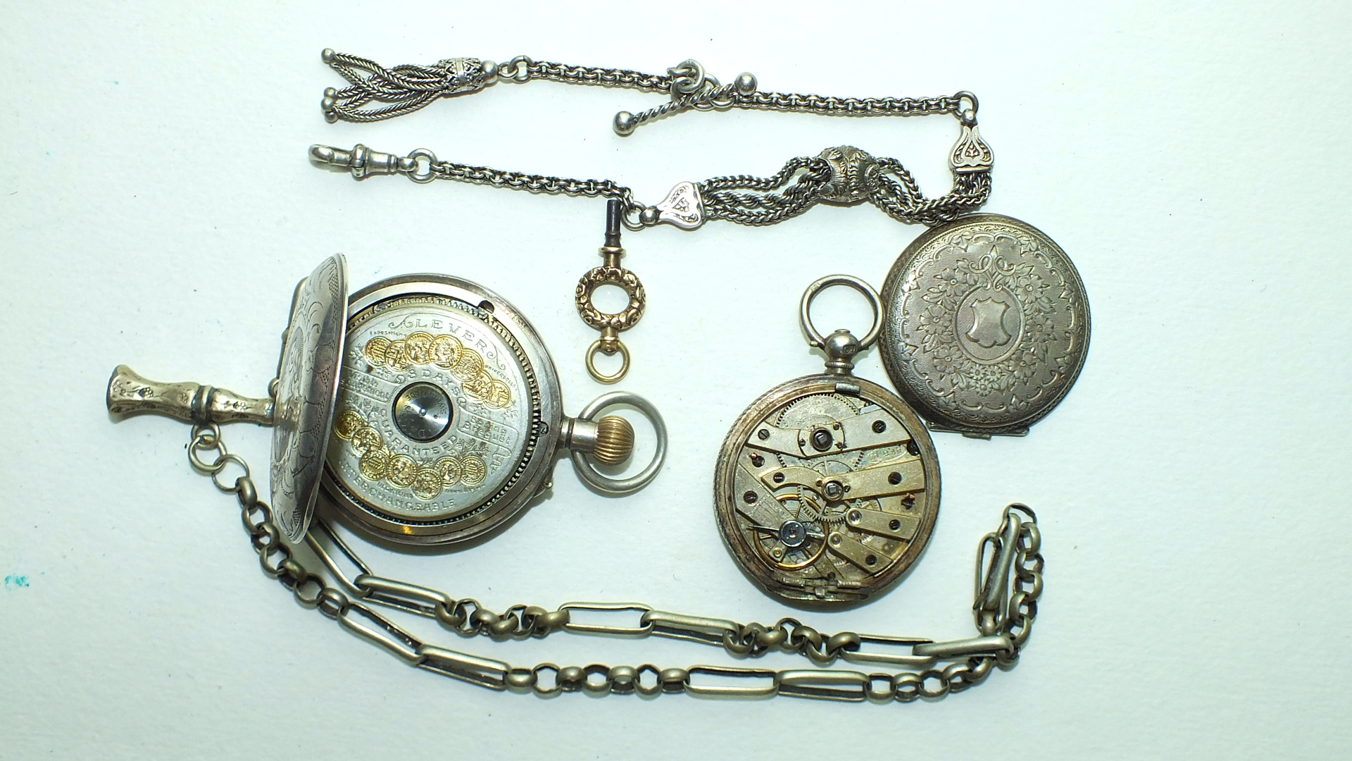 Lot 241 - A silver-cased open-face keyless pocket watch with visible 8-day escapement, (a/f) and a silver-