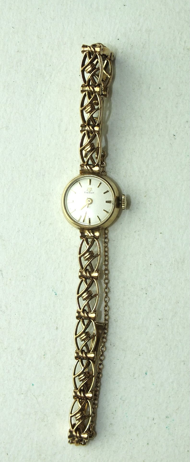 Lot 259 - Tissot, a ladies 9ct gold wrist watch, the circular dial with baton numerals, on 9ct gold fancy-link