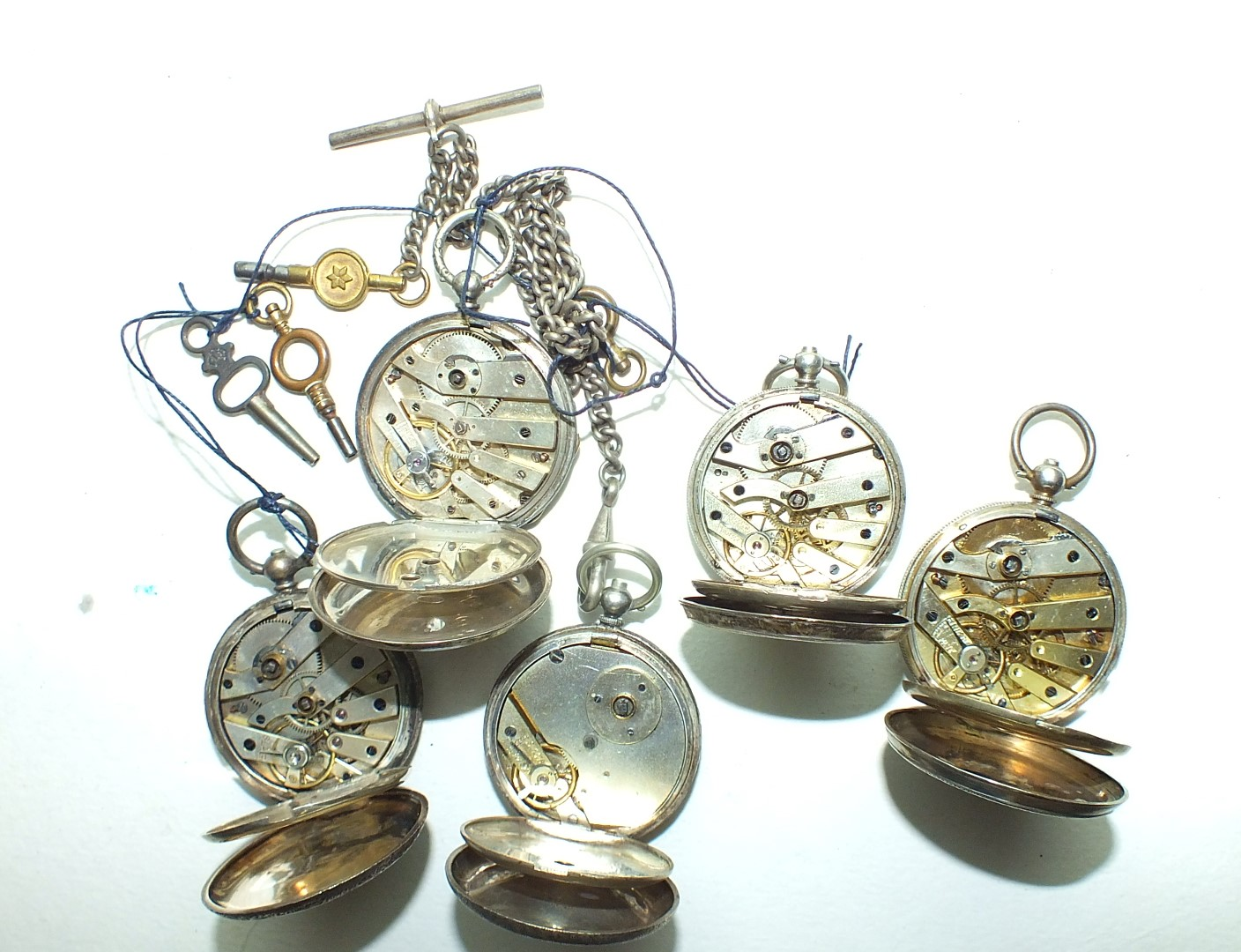 Lot 246 - Five Continental silver-cased key-wind pocket watches of small size, (a/f), (5).