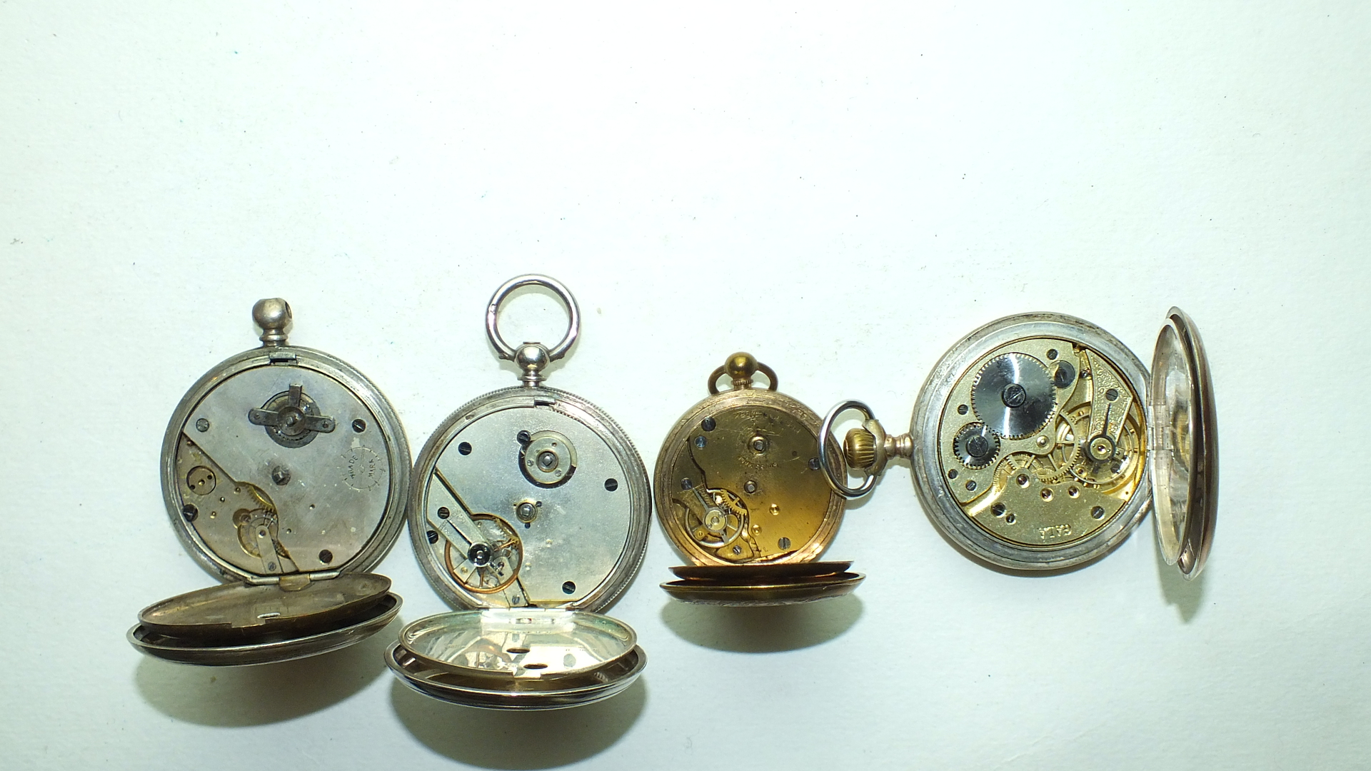 Lot 248 - A Continental silver hunter-cased keyless pocket watch and three other pocket watches, (4).