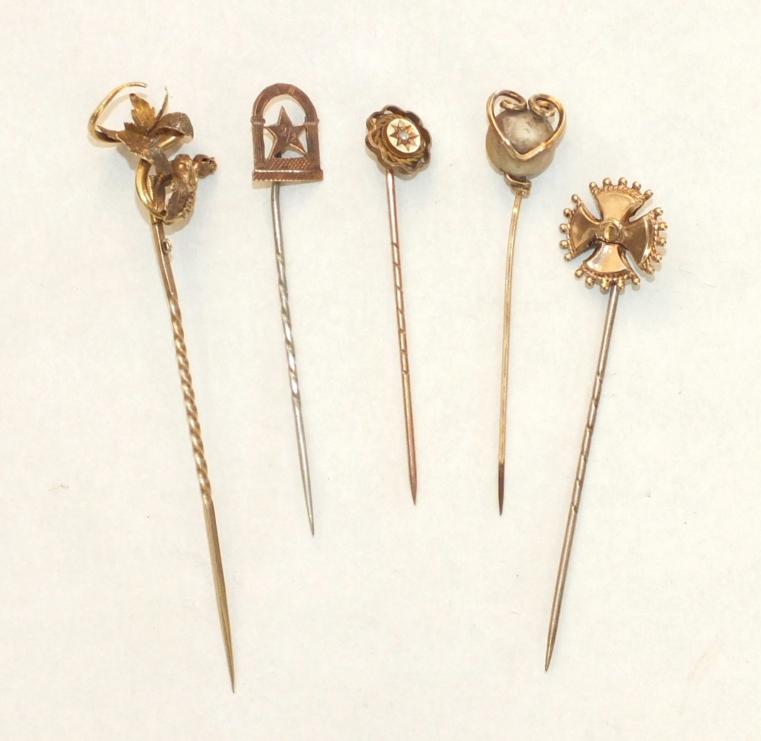 Five various Victorian and Edwardian stick pins, (5).