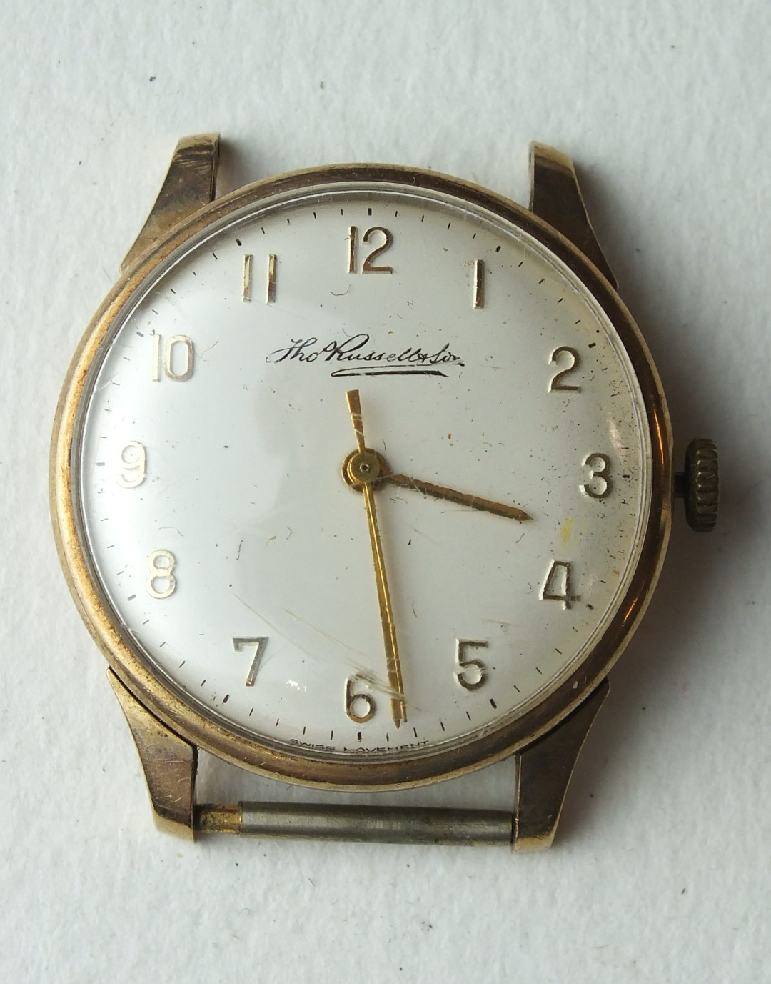 Lot 240 - Thomas Russell & Son, a 1970's gents 9ct-gold-cased wrist watch, 20g, with inscription to back,