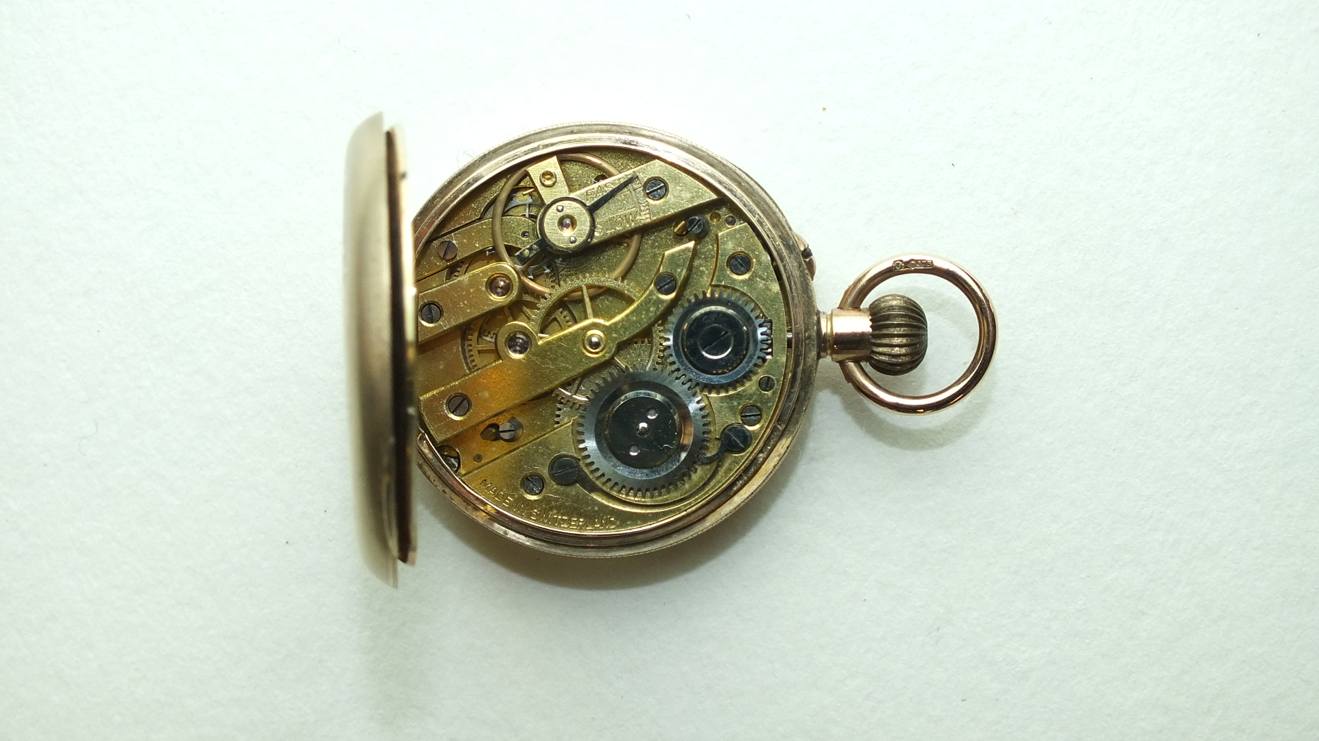 Lot 273 - A ladies Continental 9ct-gold-cased open-face keyless pocket watch, the engraved gilded face with