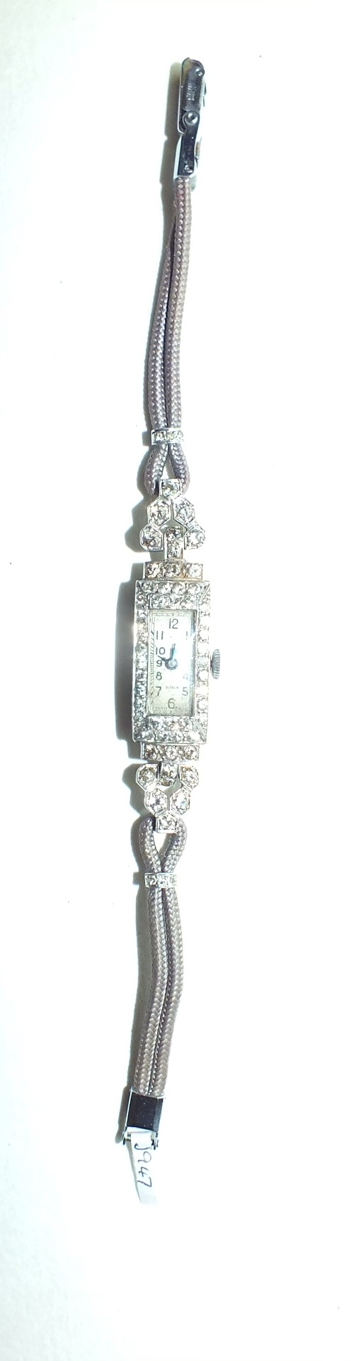 Lot 231 - Buren, a ladies Art Deco cocktail watch, the rectangular platinum case pavé-set with brilliant-cut