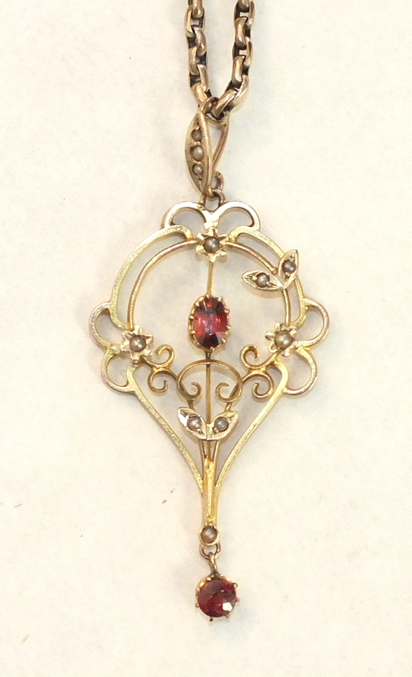 A garnet and pearl-set open-work pendant, (a/f), on belcher-link chain, unmarked, 9.1g.