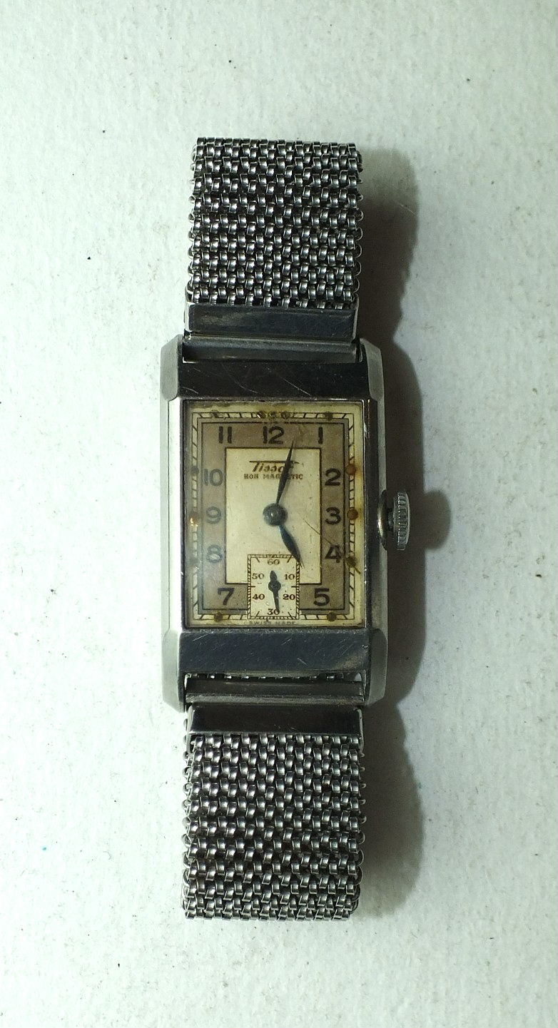 """Lot 251 - Tissot, a gentleman's 1930's rectangular wrist watch, the two-tone dial marked """"Tissot Non-"""