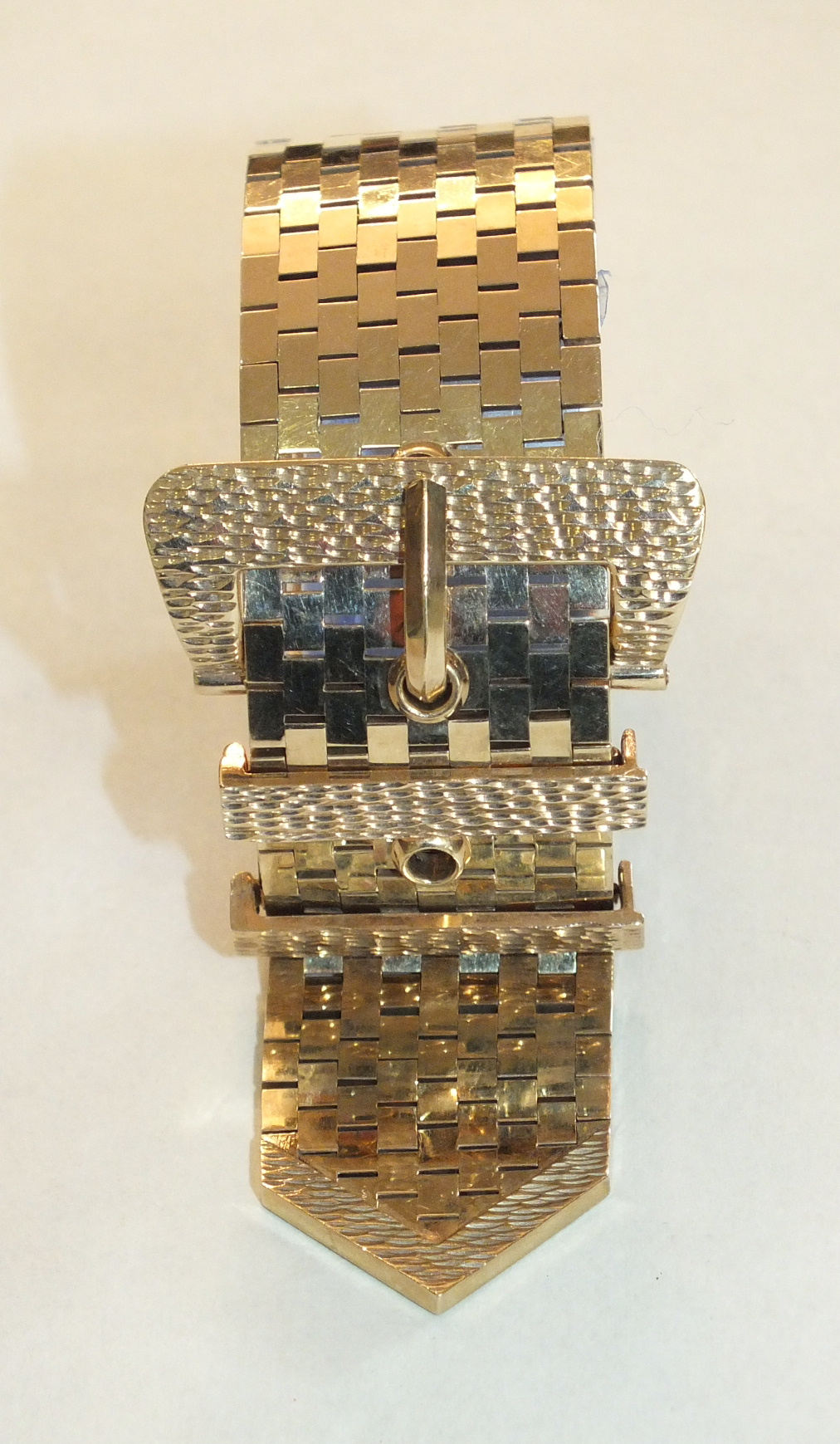 A 9ct gold brick-link wide bracelet in the form of a belt and buckle, with textured buckle and two - Image 2 of 2