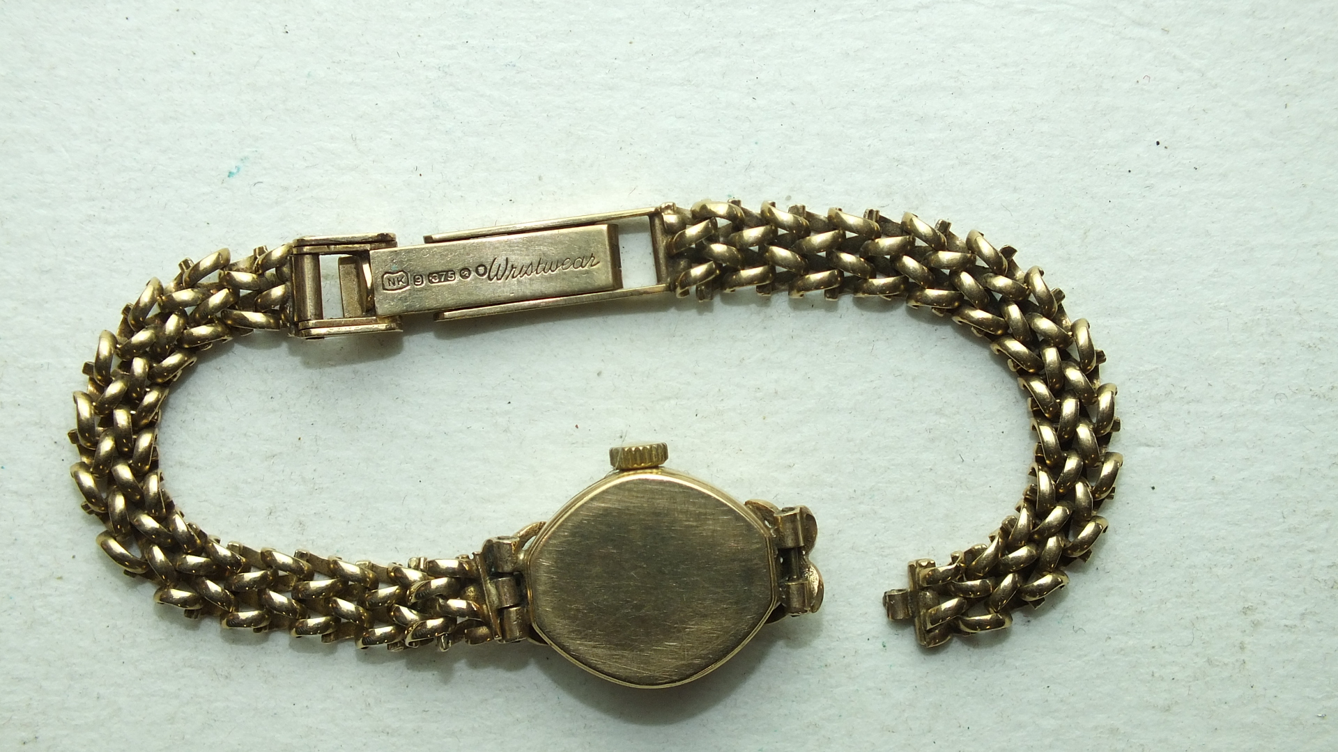 Lot 252 - Rotary, a ladies 9ct gold wrist watch on 9ct gold chain bracelet, 13.8g, (bracelet a/f).