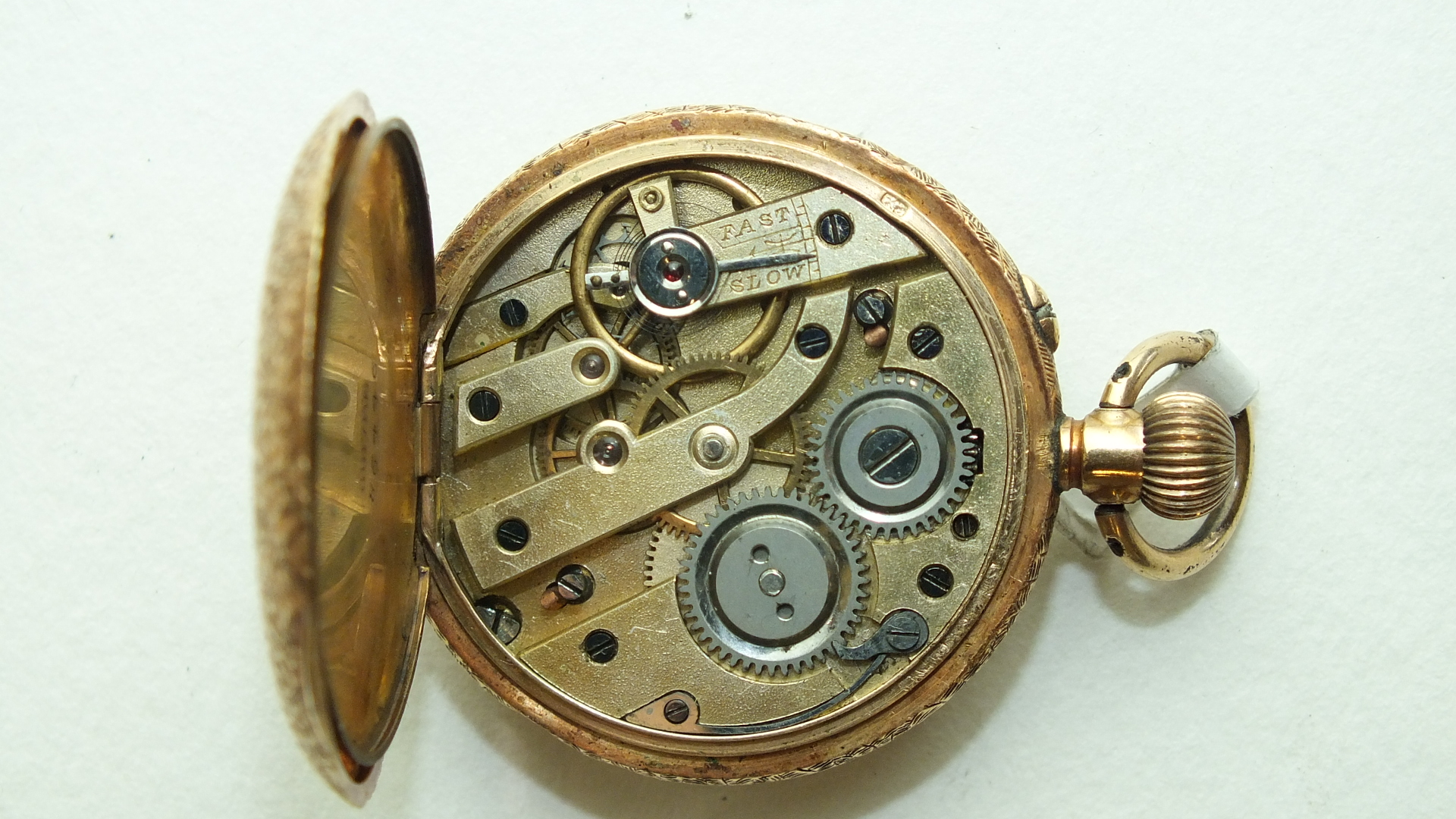Lot 279 - A Continental ladies 14k gold open-face keyless pocket watch, the white enamel dial with Arabic