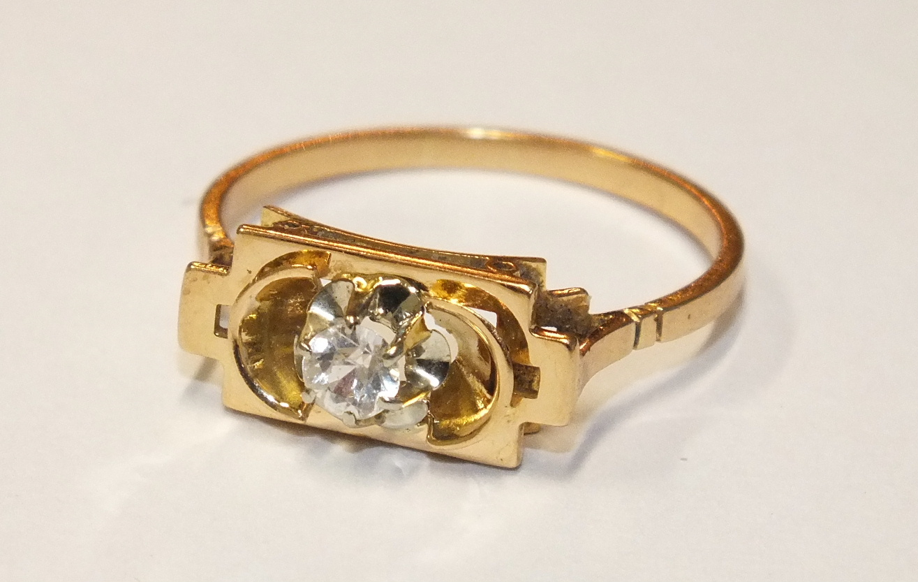 Lot 144 - An 18ct gold ring with French marks, set a synthetic white stone, size P½, 2.6g.