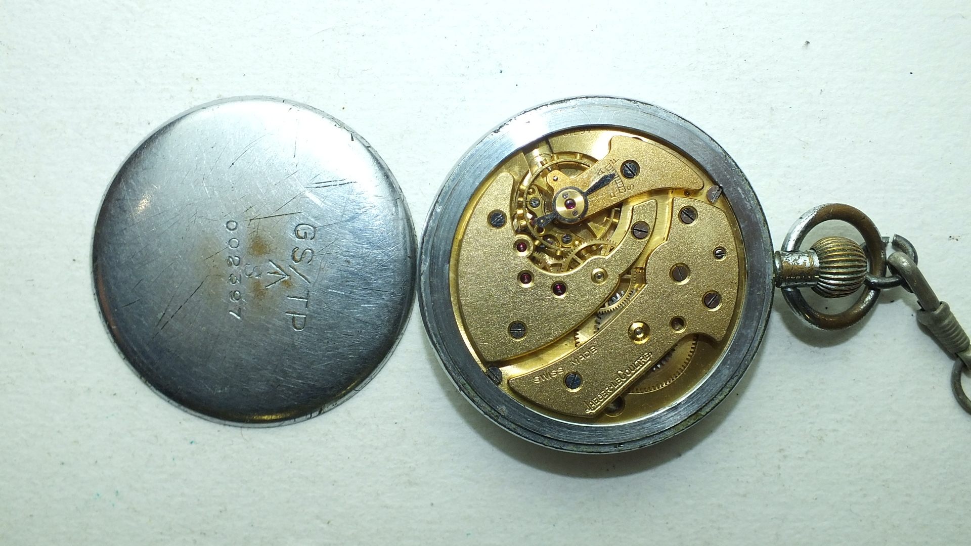 Lot 254 - Jaeger LeCoultre, a military issue open-face pocket watch, the signed black dial with luminous