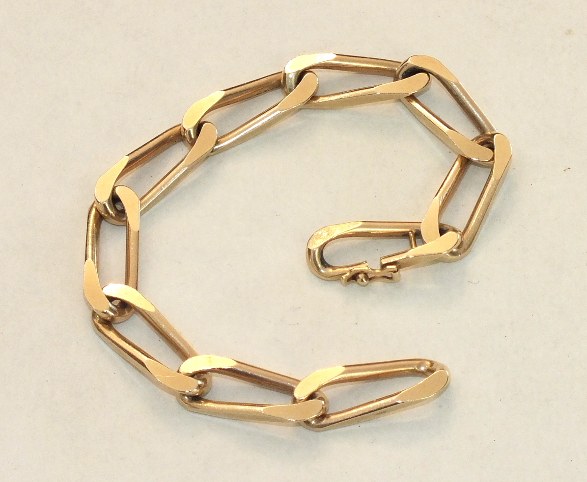 A 9ct gold bracelet of elongated and flattened curb links, with concealed clasp, 19cm long, 26g.