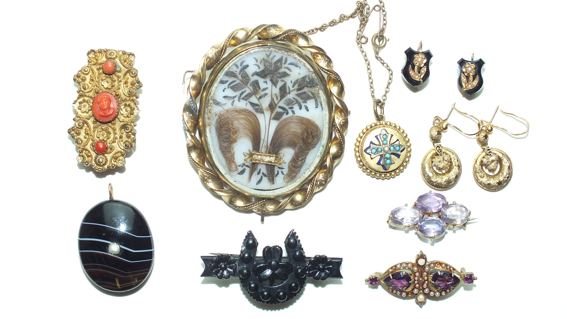 A 19th century gilt metal brooch set coral, a banded pendant, a gilt metal swivel brooch and other