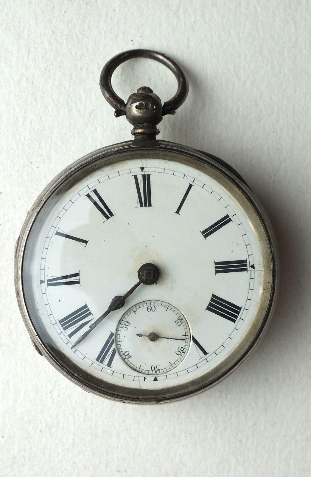 Lot 245 - A silver-cased open-face fusée pocket watch, the white enamel dial with seconds subsidiary,
