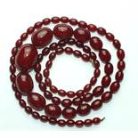 A necklace of cherry-red phenolic Bakelite graduated beads, 92cm long, 68g.