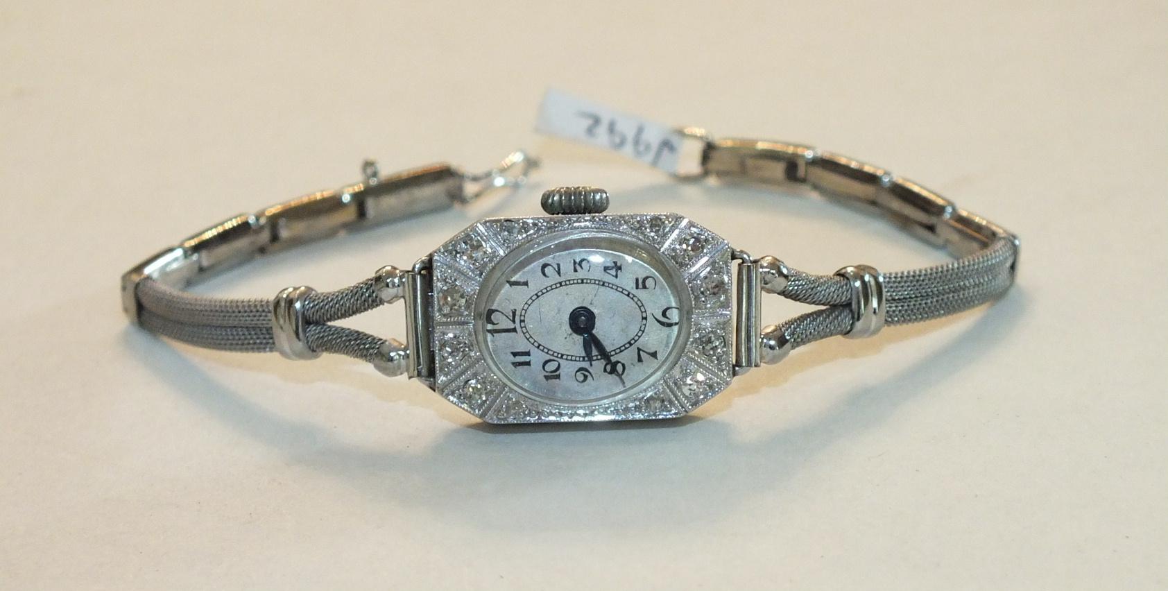 Lot 232 - A ladies Art Deco cocktail watch, the octagonal platinum case with 8/8-cut diamond-set bezel, on 9ct