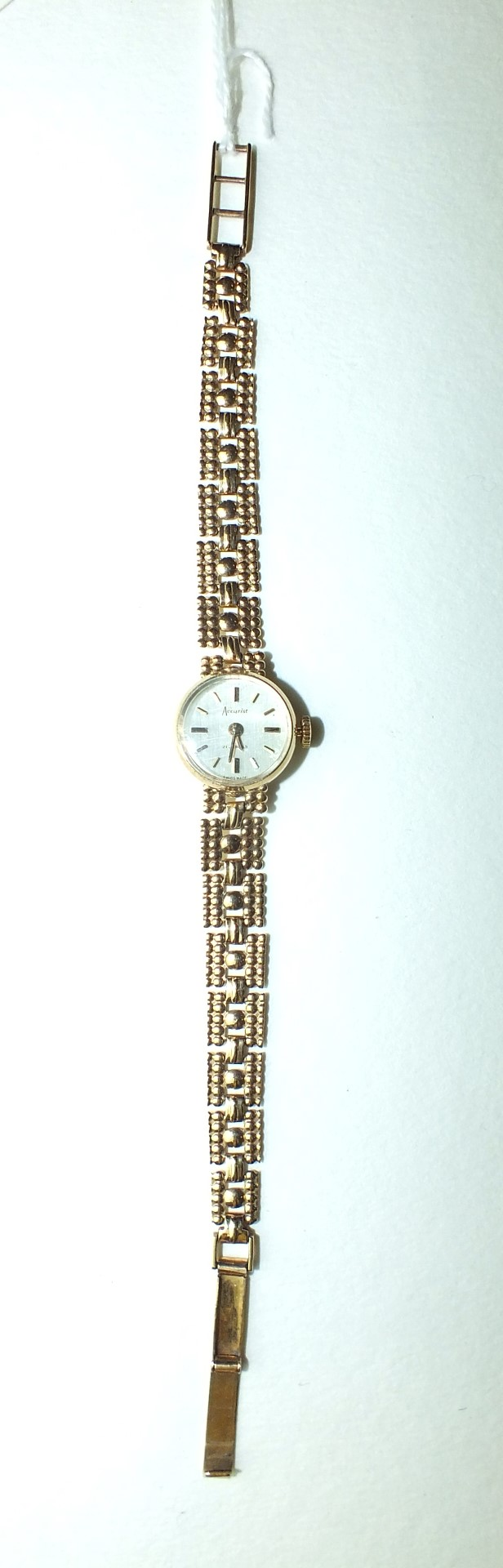Lot 270 - Accurist, a ladies 9ct-gold-cased wrist watch, the circular dial with baton numerals, on gold