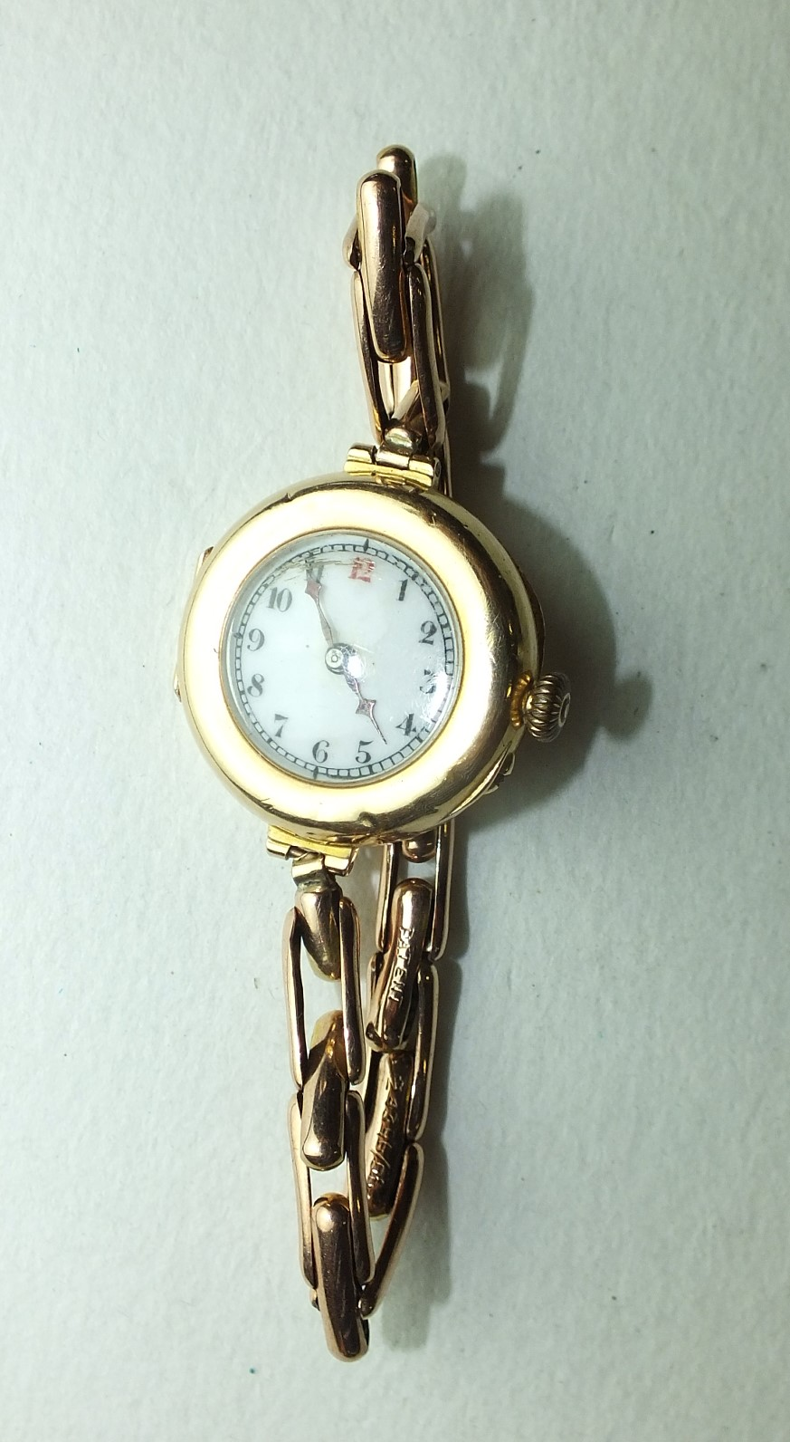 Lot 237 - A ladies 15ct-gold-cased wrist watch on 9ct gold sprung bracelet, gross weight 20.5g.