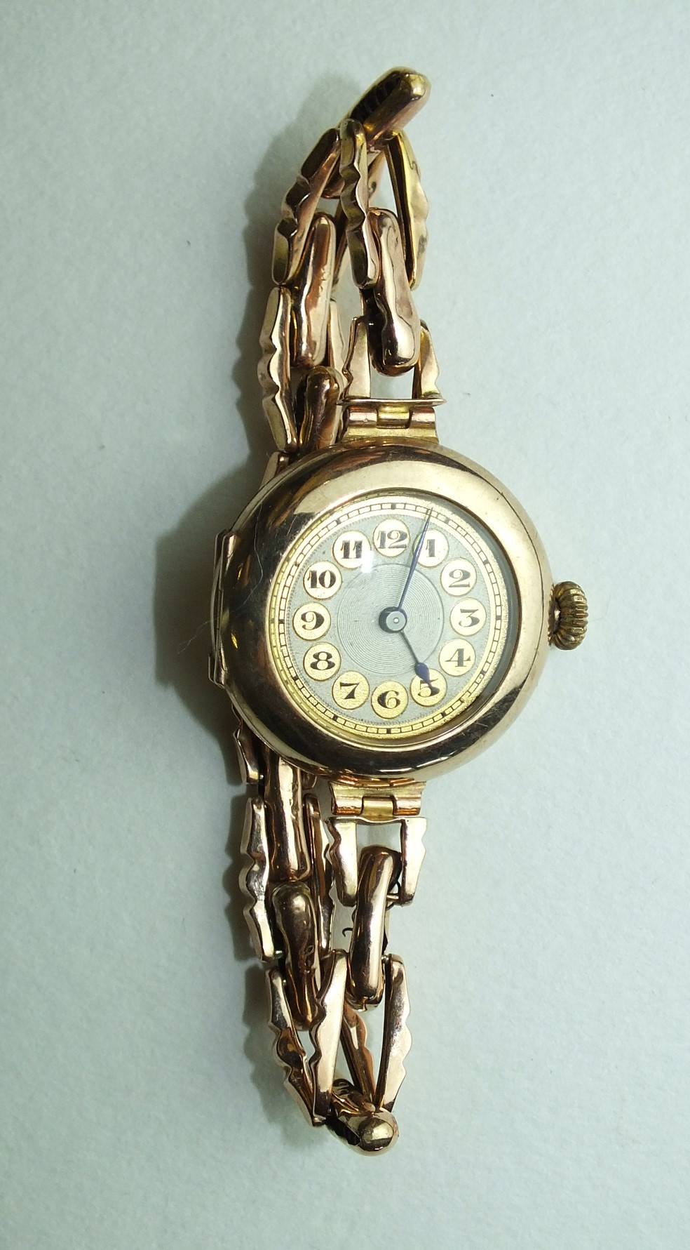 Lot 268 - A ladies 9ct-gold-cased wrist watch, the circular gold dial with Arabic numerals, on 9ct gold sprung