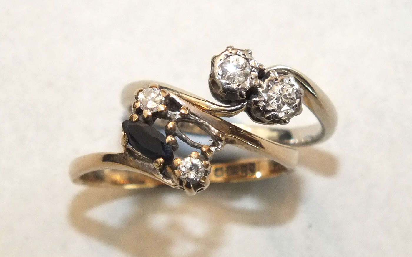 A diamond crossover ring with 18ct white gold and platinum mount, size J, 2.2g and a 9ct gold ring