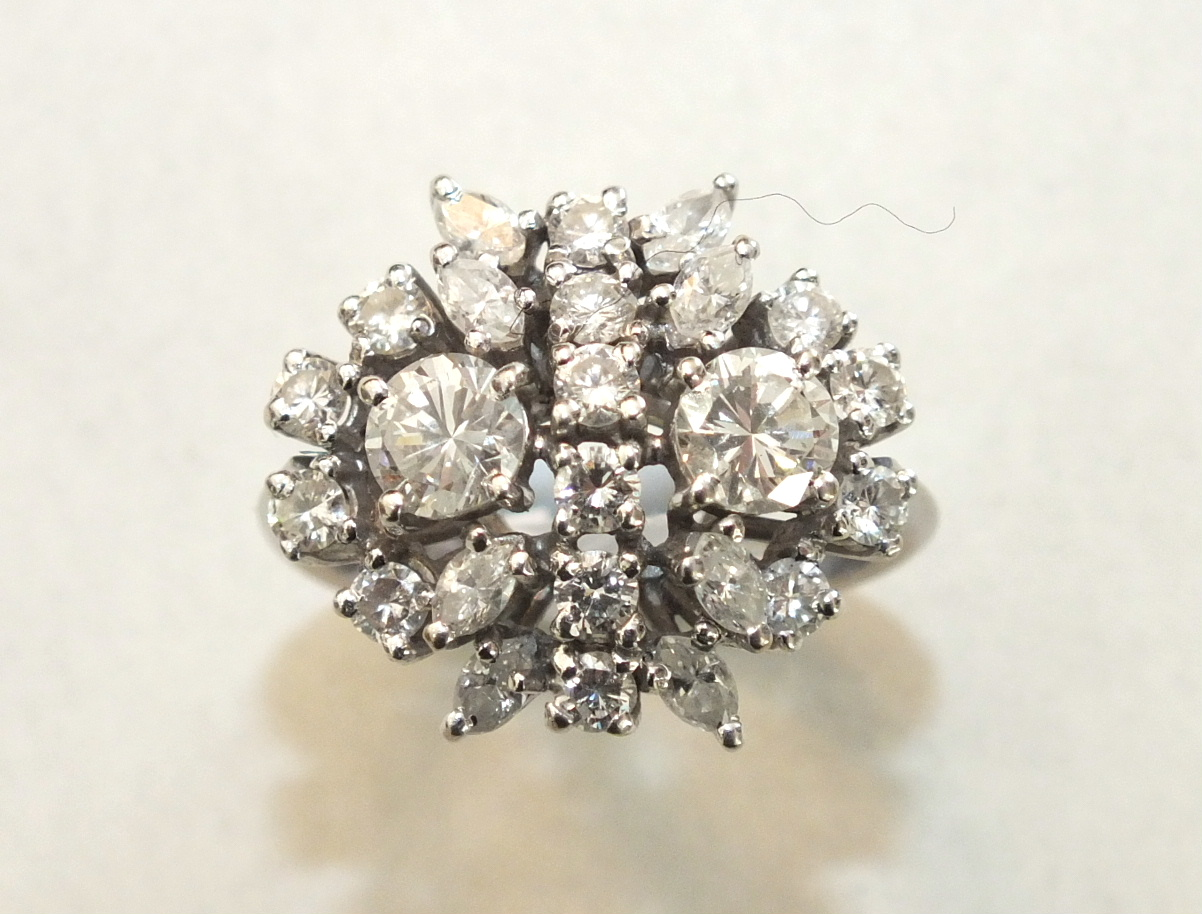 A diamond cluster ring claw-set twenty-four brilliant and marquise-cut diamonds, in 18ct gold