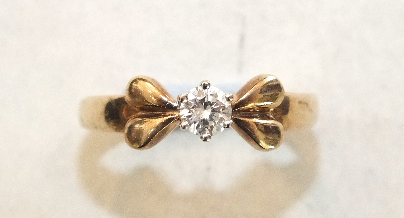 A solitaire diamond ring claw-set a brilliant-cut diamond of approximately 0.3ct, in 9ct gold mount,